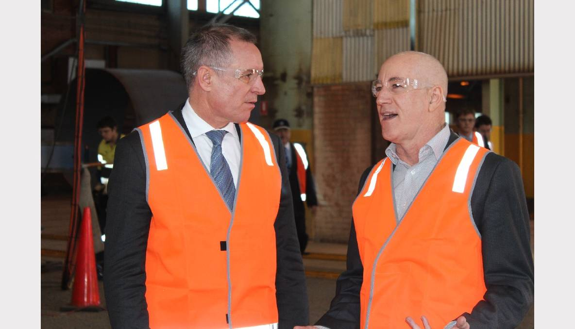 PREMIER SUPPORTS RENEWABLE ENERGY: Labor candidate Eddie Hughes and South Australian Premier Jay Weatherill stand among the components of wind turbines that will be constructed in Whyalla and transported to the Snowtown II Wind Tower Project.